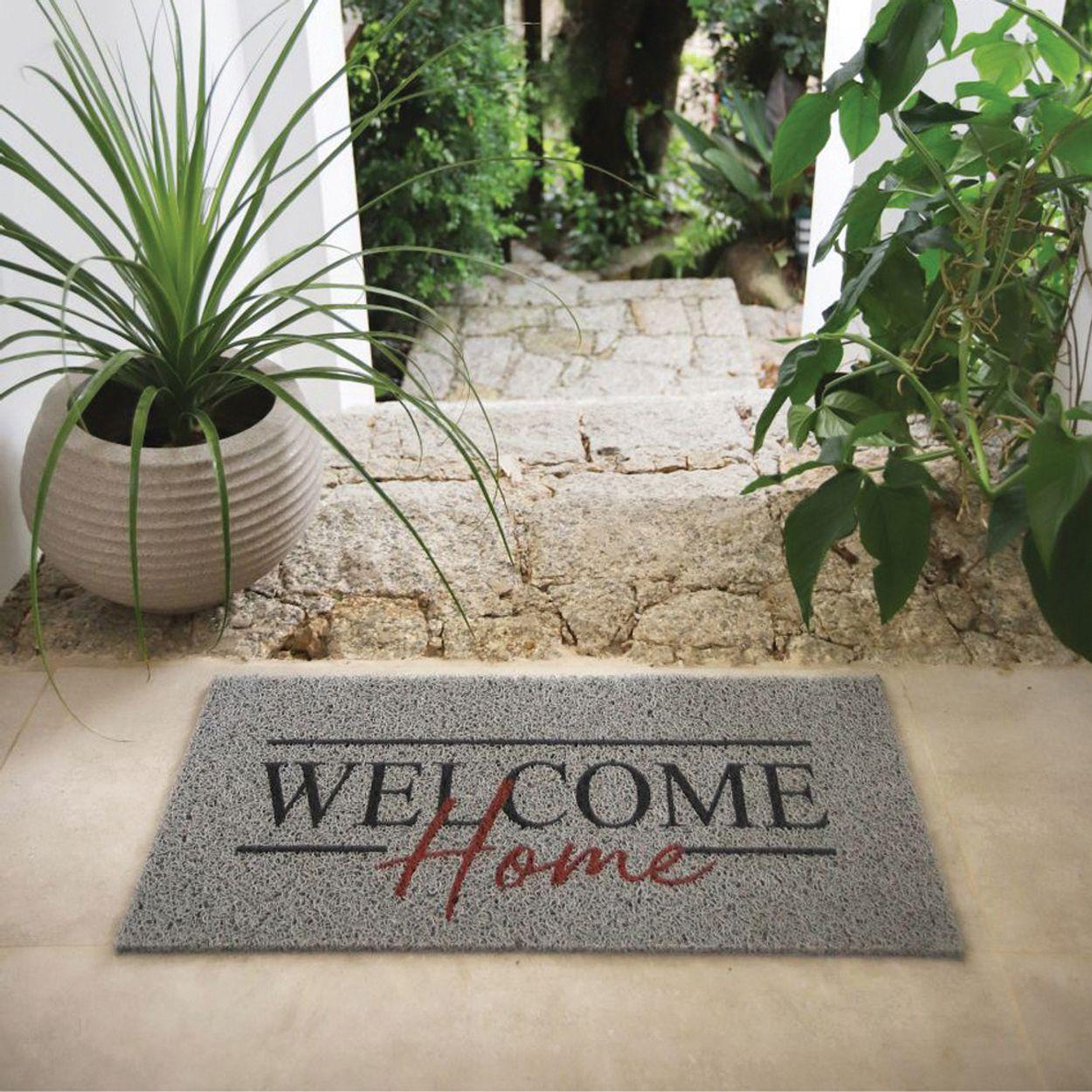 imagem de um capacho escrito welcome home